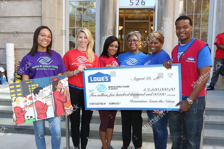 """Lowe's presents a $2.5 million check to Boys & Girls Clubs of America for """"Renovation Across the Nation"""" on  in New York. This initiative will award 50 Clubs, one per state, with $50,000 each for much needed refurbishments, improvements and enhancements. From left to right, Debora C., Club member from Boys & Girls Clubs of Central Florida, Misty Marston of BGCA, Olympic legend Dominique Dawes, Shirley Lewis and Dominique Jones from Boys & Girls Club of Harlem and James Frison from Lowe's"""