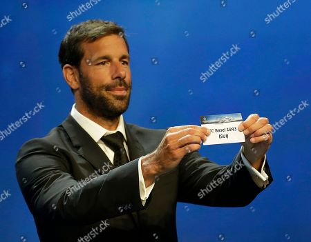 Ruud van Nistelrooy Former players Ruud van Nistelrooy shows the name of FC Basel, that will play in Group A, during the UEFA Champions League draw