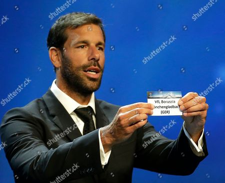 Ruud van Nistelrooy Former player Ruud van Nistelrooy shows the name of Borussia Monchengladbach, that will play in Group F, during the UEFA Champions League draw