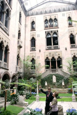 Stan Kozak, Chief Horticulturist of the Gardner Museum, guides Laura Bush though a tour of the interior courtyard garden. The museum is modeled after a 15th century Venetian Palazzo, turned inside out and surrounding the courtyard.