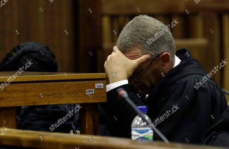 South African chief state prosecutor Gerrie Nel, reatcs as Judge Thokozile Masipa, reads her verdict during the state appeal hearing at the high court in Johannesburg, South Africa, . The State lost it's appeal challenging Masipa's six years prison sentence on Oscar Pistorius for the murder of his girlfriend, Reeva Steenkamp