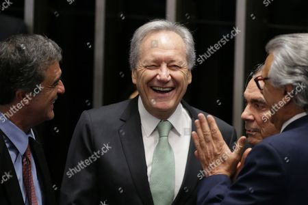 """Stock Picture of Ricardo Lewandowski, Jose Eduardo Cardozo, Ronaldo Caiado, Raimundo Lira Brazil's Supreme Court Chief Justice Ricardo Lewandowski, center, smiles during a conversation with Brazil's former Attorney General Jose Eduardo Cardozo, left, and senators, Ronaldo Caiado, right, Raimundo Lira, second right, before the start of the impeachment trial of suspended President Dilma Rousseff, in Brasilia, Brazil, . Senators are now embarking """"on their most somber duties,"""" said Lewandowski, who is overseeing the trial. """"To judge the president, (senators) must act with the utmost impartiality and objectivity, considering only the facts they are presented and the laws"""