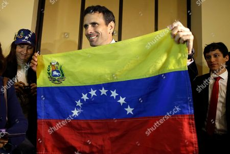 Henrique Capriles Radonski Opposition leader Henrique Capriles Radonski shows a Venezuelan flag before the start of a press conference in Lima, Peru, Thursday, 11, 2016. Capriles is in Peru on one day visit to meet with Peruvian political leaders