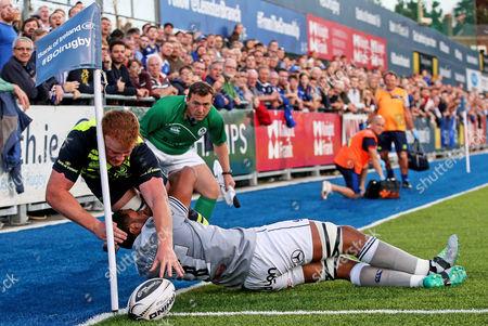 Leinster vs Bath. Bath's Toby Faletau stops Peadar Timmins of Leinster scoring a try