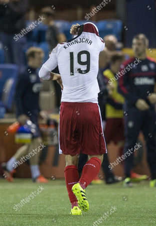 Niko Kranjcar of Rangers pulls his jersey over his head as he walks off the pitch after the final whistle in the SPFL Ladbrokes Premiership match between Kilmarnock and Rangers on 26th August 2016.