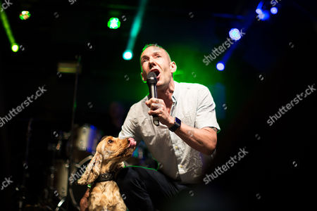 Jeremy Joseph, owner of G-A-Y, on the main stage with his dog at Manchester's Gay Village