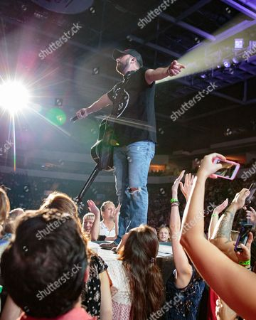 Tyler Farr performs live in concert at the H-E-B Center on Brad Paisley's Life Amplified World Tour.