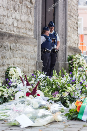 Security officers beside flowers
