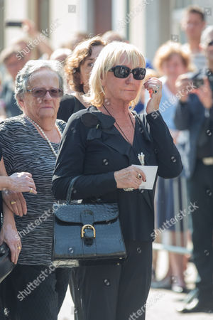The widow of Toots Thielemans following the coffin