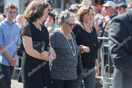 Members of the family follow the coffin