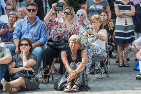 People attend the funeral
