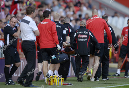 Phil Parkinson manager of Bolton Wanderers (left, white top)watches Mark Davies of Bolton Wanderers being carried on a stretcher during the Sky Bet League One match between Charlton Athletic and Bolton Wanderers played at The Valley, London on 27th August 2016