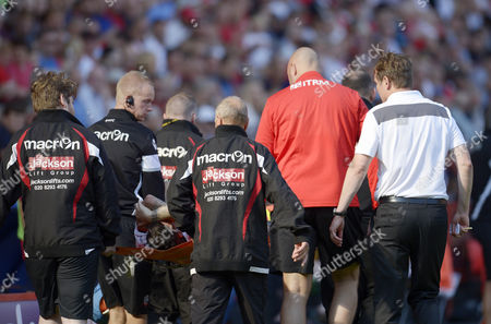 Phil Parkinson manager of Bolton Wanderers (right, white top) watches Mark Davies of Bolton Wanderers being carried on a stretcher during the Sky Bet League One match between Charlton Athletic and Bolton Wanderers played at The Valley, London on 27th August 2016