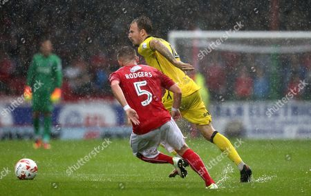 Chris Lines of Bristol Rovers goes past Anton Rodgers of Swindon Town in the heavy rain