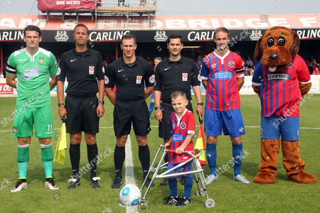 Stock Image of Mascot Harry Parker poses with the match officials and captains before Dagenham and Redbridge vs Wrexham, Vanarama National League Football at the Chigwell Construction Stadium on 27th August 2016