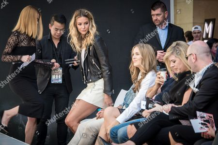 Jennifer Hawkins (C) takes a seat front row for the Myer spring fashion parade at Pitt Street Mall on August 27, 2016, in Sydney, Australia