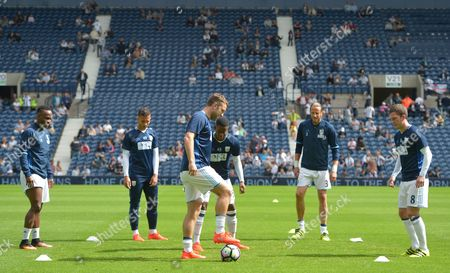 Saido Berahino of West Bromwich Albion (L) warms-up with team-mates, including Jonas Olsson and Rickie Lambert during the Premier League match between West Bromwich Albion and Middlesbrough played at The Hawthorns, West Bromwich on 28th August 2016