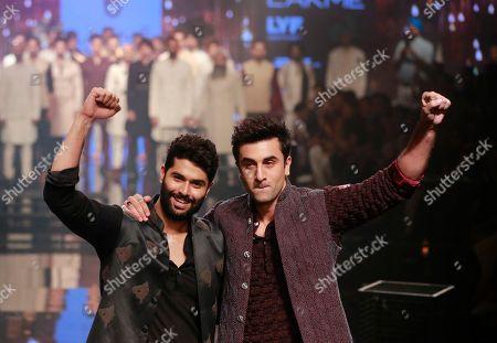 Ranbir Kapoor, Kunal Rawal Bollywood actor Ranbir Kapoor, right along with Indian designer Kunal Rawal gesture during the Lakme Fashion Week in Mumbai, India