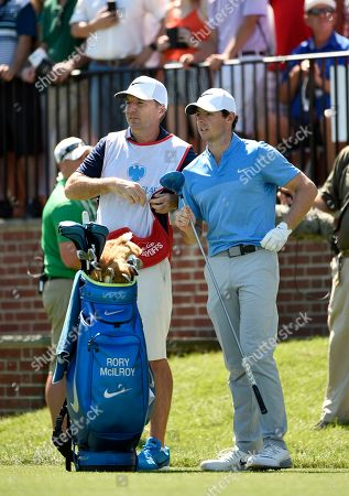 Stock Photo of Rory McIlroy, J. P. Fitzgerald, Barclays Golf Rory McIlroy of Northern Ireland and his caddy, J. P. Fitzgerald look down the fairway before McIlroy tees off from the first hole during the final round of The Barclays golf tournament in Farmingdale, N.Y
