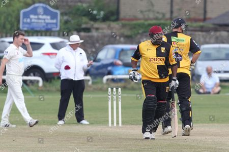 Gordon Geenidge and Chris Schofield making runs during the Lashings All-Stars World XI vs House Of Commons & Lords match at Town Malling Cricket Club, Old County Ground, West Malling