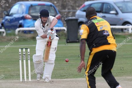 Stock Image of House Of Commons XI batsman faces the bowling of Devon Malcolm during the Lashings All-Stars World XI vs House Of Commons & Lords match at Town Malling Cricket Club, Old County Ground, West Malling