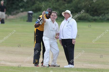 Stock Image of Nigel Adams MP getting a selfie with Alex Tudor and Umpire during the Lashings All-Stars World XI vs House Of Commons & Lords match at Town Malling Cricket Club, Old County Ground, West Malling