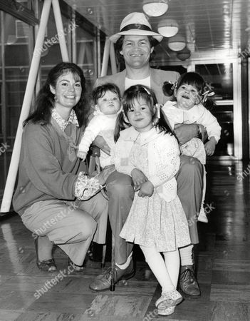 Micky Dolenz Of The Monkees At Heathrow Airport With His Wife Trina And Daughters Georgia (7months) Charlotte (3) And Emily (20 Months). Box 702 801081613 A.jpg.