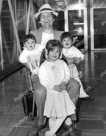 Micky Dolenz Of The Monkees At Heathrow Airport With His Daughters Georgia (7months) Charlotte (3) And Emily (20 Months). Box 702 801081625 A.jpg.