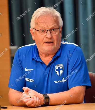 Stock Photo of Finland's head coach Hans Backe talks to the media at a press conference in Duesseldorf, Germany, . Finland faces Germany in a friendly soccer match on Wednesday in Moenchengladbach, Germany