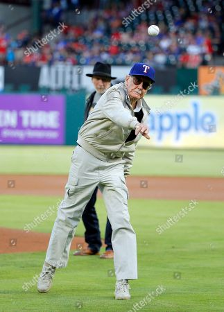 Stan Lee, Frank Miller Stan Lee of Marvel Comics fame throws out the ceremonial first pitch as Frank Miller, rear, a writer, director and actor watches, before a baseball game between the Seattle Mariners and Texas Rangers, in Arlington, Texas