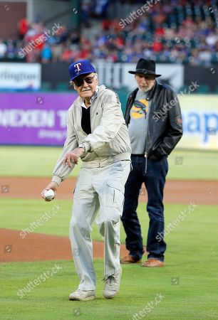 Stan Lee, Frank Miller Stan Lee of Marvel Comics fame winds up to throw out the ceremonial first pitch as Frank Miller, rear, a writer, director and actor watches, before a baseball game between the Seattle Mariners and Texas Rangers, in Arlington, Texas
