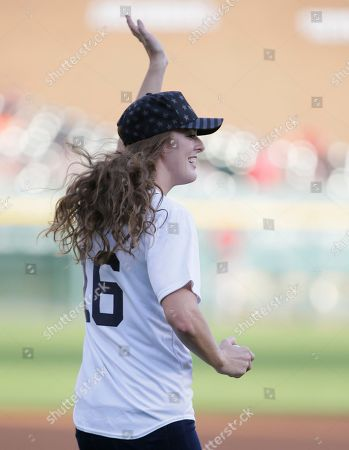 Allison Schmitt Gold medal swimmer Allison Schmitt waves to the crowd before throwing out a ceremonial first pitch before the Detroit Tigers' baseball game against the Los Angeles Angels, in Detroit