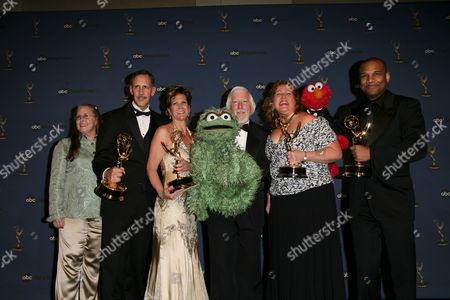 Caroll Spinney with Oscar the Grouch and Kevin Clash with Elmo