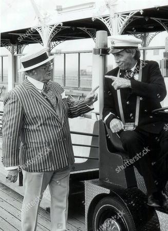 Sir Harry Secombe with guest Bernie Clifton on the pier at Weston-Super-Mare for the ITV television programme 'Highway'