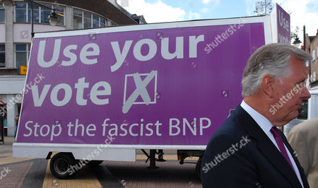 Steven Norris in front of The United Against Fascism poster campaign