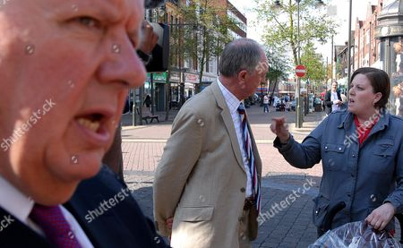 Conservative party member Steven Norris looks on as London Mayor Ken Livingstone talks with a member of the public
