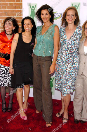 Stock Photo of Cindy Crawford with some of the honorees - Lynn Price, Yvette Corporon and Heidi Adams