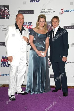 Ken Rickel and Nancy Davis with Tommy Hillfiger