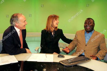 Alastair Stewart and Katie Derham with Guy Goma at the ITV News studio