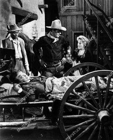 Woody Strode, James Stewart, John Wayne, Vera Miles