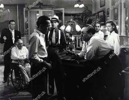 William Haade, Lionel Barrymore, Humphrey Bogart, Harry Lewis, Thomas Gomez, Dan Seymour, Lauren Bacall