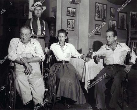 Lionel Barrymore, Harry Lewis, Lauren Bacall, Humphrey Bogart