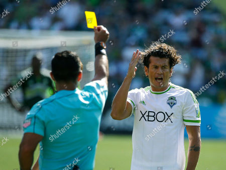 Nelson Valdez Seattle Sounders forward Nelson Valdez, right, reacts as he is shown a yellow card for dissent by head referee Hilario Grajeda, left, in the second half of an MLS soccer match against the Portland Timbers, in Portland, Ore