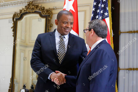 Anthony Foxx, Bruno Rodriguez U.S. Transportation Secretary Anthony Foxx shakes hands with Cuba's Foreign Minister Bruno Rodriguez, during a photo opportunity for journalists, in Havana, Cuba, . The first commercial flight between the United States and Cuba in more than a half century landed in the central city of Santa Clara on Wednesday morning, re-establishing regular air service severed at the height of the Cold War