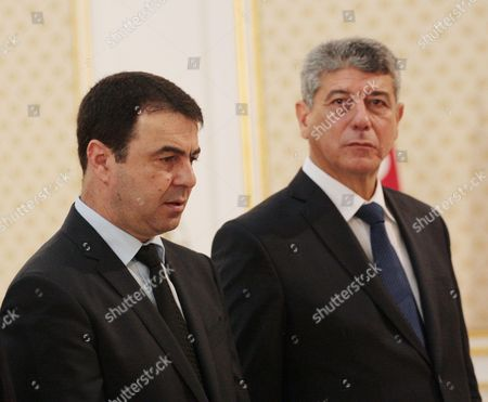 Tunisian newly Minister of Justice Ghazi Jribi (R) and Tunisian Interior Minister Hedi Majdoub attend for the first cabinet meeting of the newly elected Prime Minister at Carthage Palace