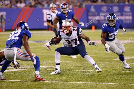 D.J. Foster New England Patriots running back D.J. Foster (27) maneuvers between New York Giants' Mykkele Thompson (22) and J. T. Thomas (55) during the first half of a preseason NFL football game. Foster fumbled the ball on the play. The ball was recovered by the Giants
