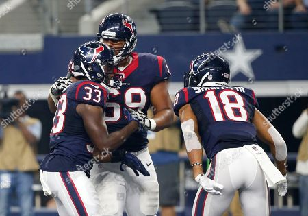 Akeem Hunt, Andrew McDonald, Cecil Shorts Houston Texans' Akeem Hunt (33) is congratulated on his touchdown run by Andrew McDonald, center, and Cecil Shorts (18) in the first half of a preseason NFL football game against the Dallas Cowboys, in Arlington, Texas