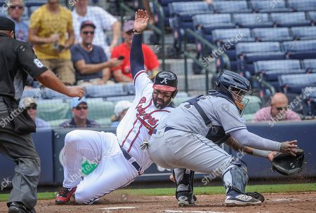 Hecter Sanchez, Matt Kemp Atlanta Braves' Matt Kemp slides safely past San Diego Padres catcher Hecter Sanchez, right, to score on an Anthony Recker two run line drive single to right field during the fifth inning of a baseball game, in Atlanta