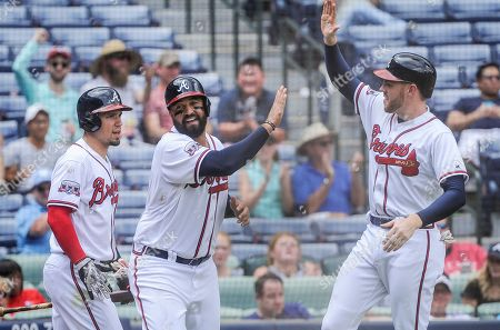 Matt Kemp, Freddie Freeman, Jace Peterson Atlanta Braves' Matt Kemp celebrates at home plate with Freddie Freeman, right, and Jace Peterson, left, after scoring on a two-run single line drive to right field by Anthony Recker during the fifth inning of a baseball game against the San Diego Padres, in Atlanta