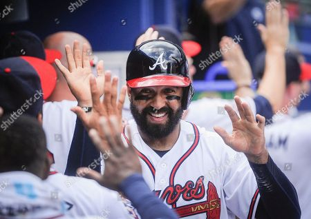Matt Kemp Atlanta Braves' Matt Kemp celebrates in the dugout after scoring on a two run single line drive to right field by Anthony Recker during the fifth inning of a baseball game against the San Diego Padres, in Atlanta